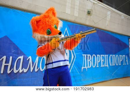 MOSCOW - APR 8, 2017: Man in fox costume with gun at match of Russian Volleyball Championship Dynamo (Moscow) - Nova (Novokuibyshevsk) in Palace of Sports Dynamo