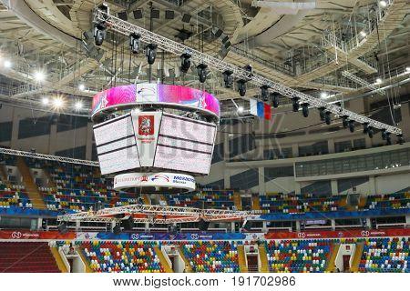 MOSCOW - APR 7, 2017: Big displays in basketball court and grandstands in Megasport stadium, construction of stadium was completed in 2006, number of seats is 14 thousand
