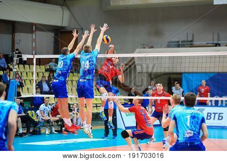 MOSCOW - APR 8, 2017: Double block and security of attack at match of Russian Volleyball Championship Dynamo (Moscow) - Nova (Novokuibyshevsk) in Palace of Sports Dynamo