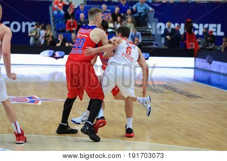 MOSCOW - APR 7, 2017: Players at basketball game Euroleague CSKA Moscow (Russia) - Olympiakos (Greece) in Megasport stadium