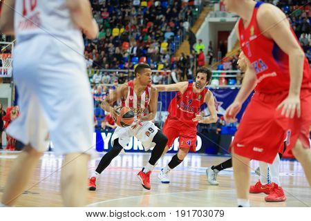 MOSCOW - APR 7, 2017: Players run with ball at basketball game Euroleague CSKA Moscow (Russia) - Olympiakos (Greece) in Megasport stadium