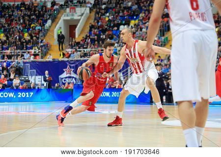 MOSCOW - APR 7, 2017: Player leads ball at basketball game Euroleague CSKA Moscow (Russia) - Olympiakos (Greece) in Megasport stadium