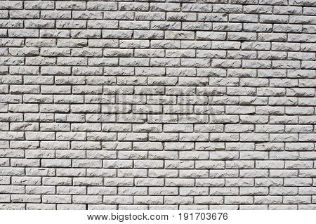 Wall of solid white bricks. Background construction of the walls of the building.