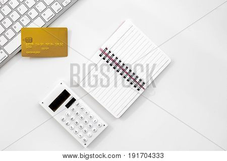 business purchasing with credit cards, keyboard and notebook on banker work desk white background top view space for text