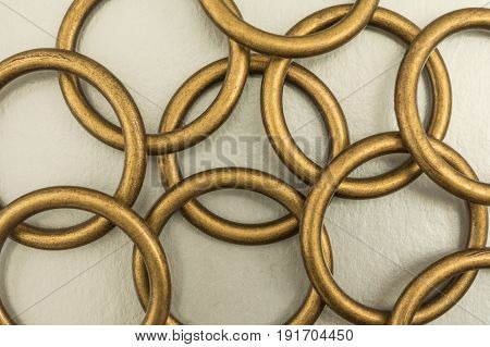 Metal Rings On A Silvery Background