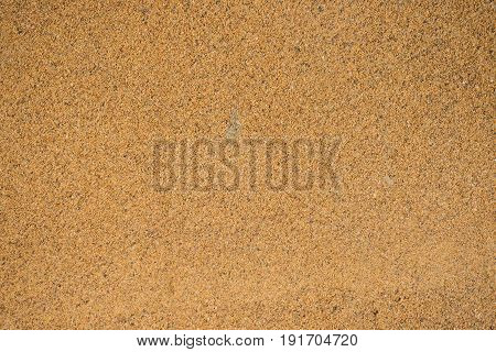 Background Industrial sand for construction works. Natural material for bricks and concrete products - loose rock, which grains of feldspar, mica, quartz and other minerals.