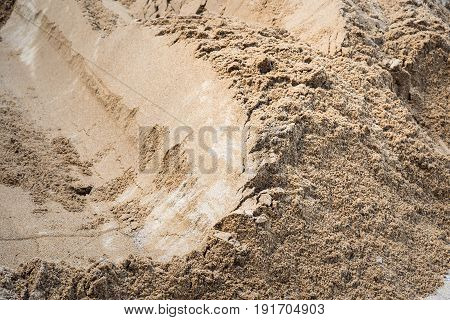 Texture of Industrial sand for construction works. Natural material for bricks and concrete products - loose rock, which contains grains of feldspar, mica, quartz and other minerals.