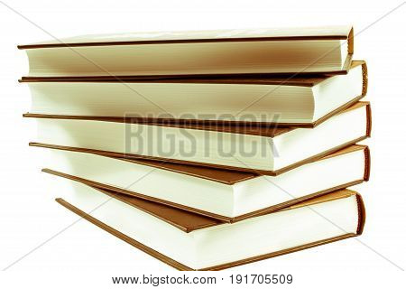 stack of ald books isolated on white