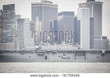 USS Kearsarge (LHD 3) passes Lower Manhattan WTC Financial District on the Hudson River during the Parade of Ships at the start of Fleet Week New York, JERSEY CITY NJ MAY 24 2017.