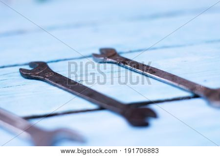 Tool wrenches on a wooden blue background