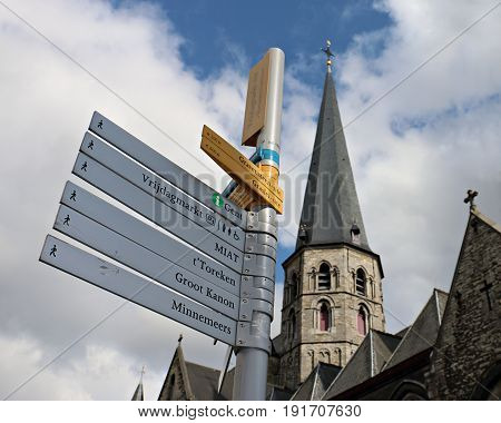Directional Sign in Ghent Belgium against a Partly Cloudy Sky
