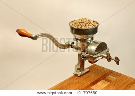 Vintage Hand Cranked Grain Mill on Wood Table