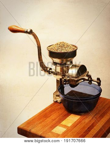 Vintage Hand Cranked Grain Mill on Wooden Table