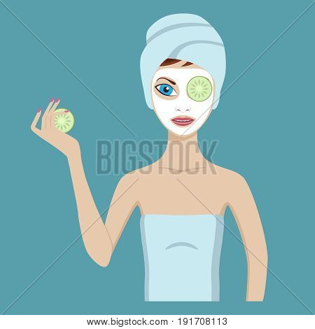 Cute girl in a cosmetic mask  puts cucumbers on eyes.