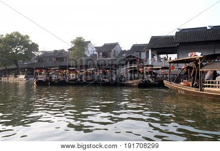 XITANG - FEBRUARY 20: Tourist boats on the water canals of Xitang Town in Zhejiang Province, China, February 20, 2016.