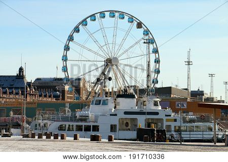 Ferris Wheel and small Ferry from Market Square, Helsinki, Finland