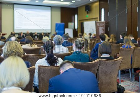 Business Meetings Concepts. People at the Law Conference Listening to The Hosts in Front of The Big Screen.Horizontal Image Orientation