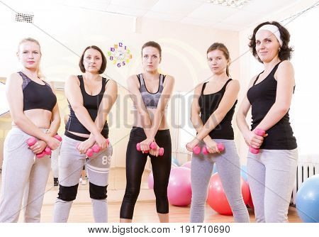 Sport Concepts and Ideas. Five Female Caucasian Athletes Standing with Barbrells Together in Sport Class.Horizontal Image