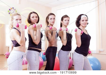 Sport Ideas. Five Female Caucasian Athletes Standing with Barbrells Together in Sport Class.Horizontal Image Orientation