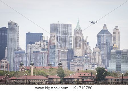US Marine Corps Ironhorse 01 H-461 helicopter flies above Ellis Island on the Hudson River during the Parade of Ships for Fleet Week New York, JERSEY CITY NJ MAY 24 2017.