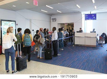 NEW YORK- JUNE 9, 2017: Passengers boarding JetBlue flight to Havana, Cuba at JetBlue Terminal 5 at John F Kennedy International Airport in New York