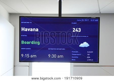 NEW YORK- JUNE 9, 2017:  A sign at JetBlue Terminal 5 at John F Kennedy International Airport in New York indicating that the destination is Havana, Cuba