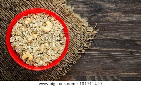 Oatmeal With Nuts Cashews. Oatmeal On A Wooden Table. Oatmeal Top View. Healthy Food .