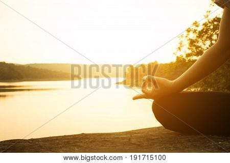 Silhouette young women yoga on nature Concept yoga.