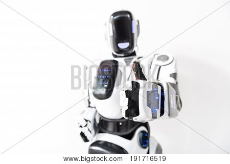 I am cool. Affable robot standing and showing focus thumb up. Isolated. Copy space on left side