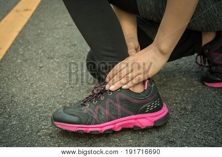 Young women accident ankle sprained over from running.