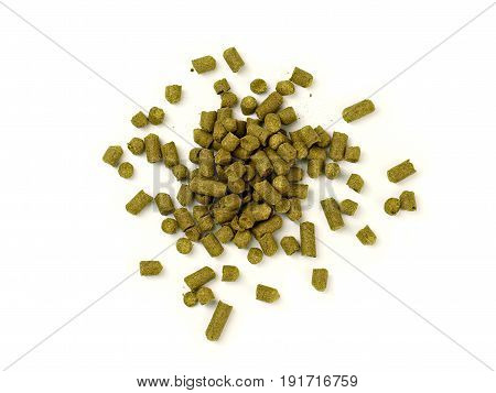 Small Piles of Pelletized Hops on Isolated White Background