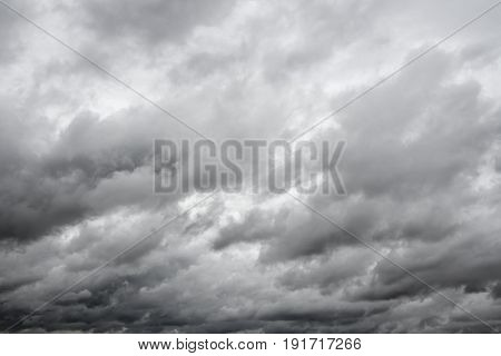 Dramatic overcast cloudy sky. Clouds flying over horizon cloudscape.