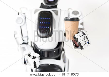 Coffee break. Close-up of paper cup of espresso in hand of modern robot. Isolated background