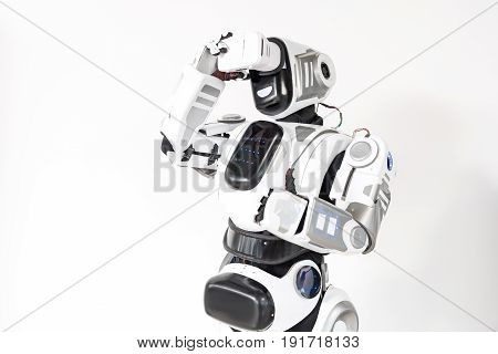 Great effect. Overjoyed cyborg standing with virtual reality goggles and expressing emotions while using device. Isolated background