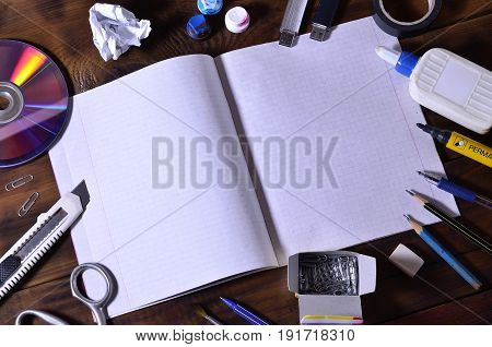 A School Or Office Still Life With An Open School Notebook Or Checkbook And Many Office Supplies. Th