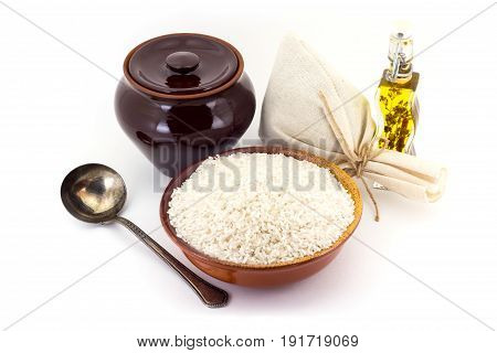 The Composition Of Rice Groats In A Clay Pial Next To A Clay Pot And A Copper Spoon,