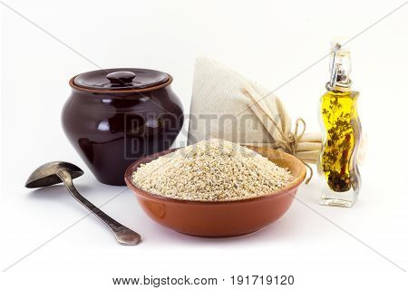 The Composition Of The Barley Groats In A Clay Pial Next To A Clay Pot And A Copper Spoon,