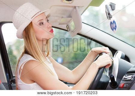 Distracted Woman Driving Her Car Looking In Mirror