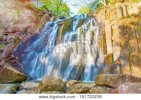 a beautiful waterfall in the forest. Wildlife, waterfalls in a deserted forest. taiga. strong and tall waterfall in forest