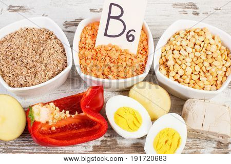 Products And Ingredients Containing Vitamin B6 And Dietary Fiber On Old Rustic Board
