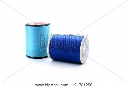 Two blue thread isolated on white background