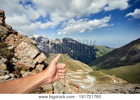 Man Show Thumb Up In The Mountains