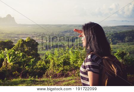 young traveler backpacker looking forward at sun to see landscape view of mountain at sunrise timeFreedom wanderlustKhao Samed Nang Chee ViewpointPhang NgaThailand