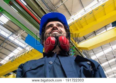 Smiling worker in an industrial site