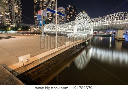 Melbourne, AUSTRALIA - June 15 2015: Webb bridge at south wharf the iconic modern design with Aboriginal tales of Melbourne, Australia.