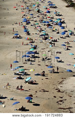 California Beach From Above With Many People And Umbrellas
