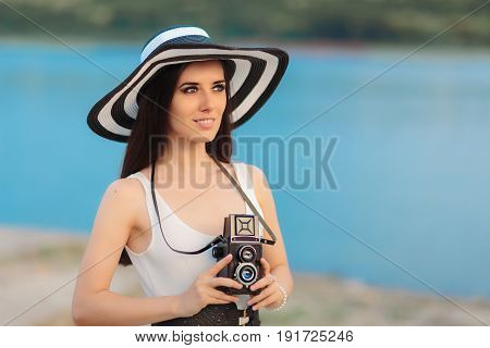 Summer Tourist Girl with Retro Camera and Big Straw Hat