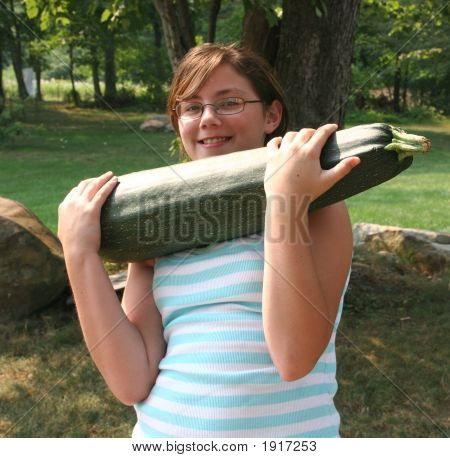 Girl With Large Zucchini