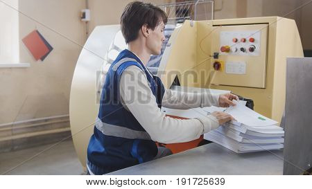 Machine working in printing house, polygraph industry - close up