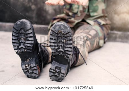 Female soldiers of sitting on the floor.